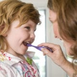 Mom-daughter-brushing-teeth