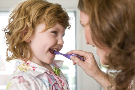 mom-daughter-brushing-teeth.jpg